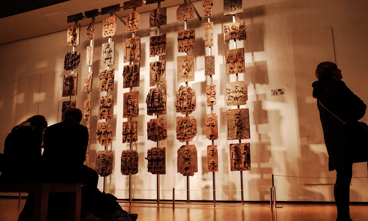Visitors view the contentious Benin plaques exhibit (more commonly known as the Benin bronzes) in the British Museum in London, the UK, on February 13, 2020. Photo: AFP