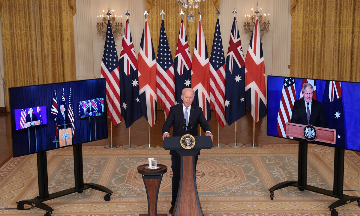 US President Joe Biden speaks during an event in the East Room of the White House on September 15, 2021 in Washington, DC. Biden announced a new national security initiative in partnership with Australian Prime Minister Scott Morrison (L) and UK Prime Minister Boris Johnson (R). Photo: AFP