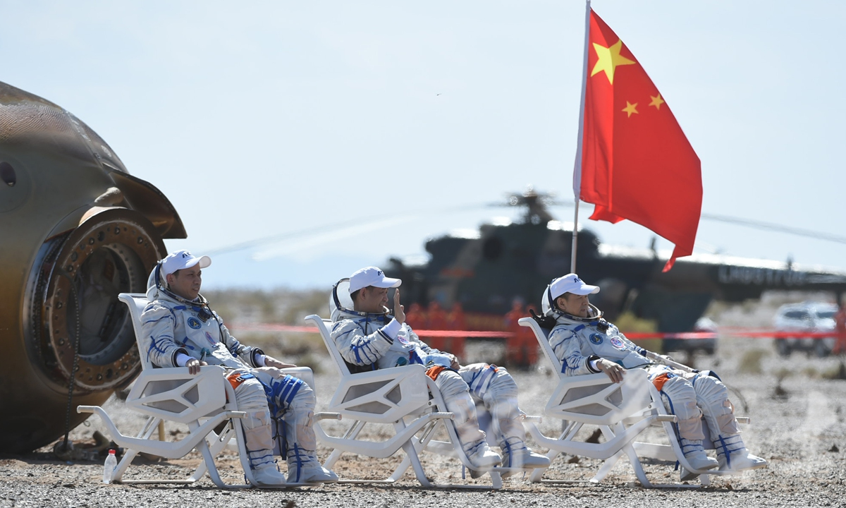 The three taikonauts, mission commander Nie Haisheng(center), Liu Boming(right) and Tang Hongbo, emerged from the Shenzhou-12 return capsule on Friday, all in good health, drawing a perfect conclusion to the mission. Photo: Xinhua