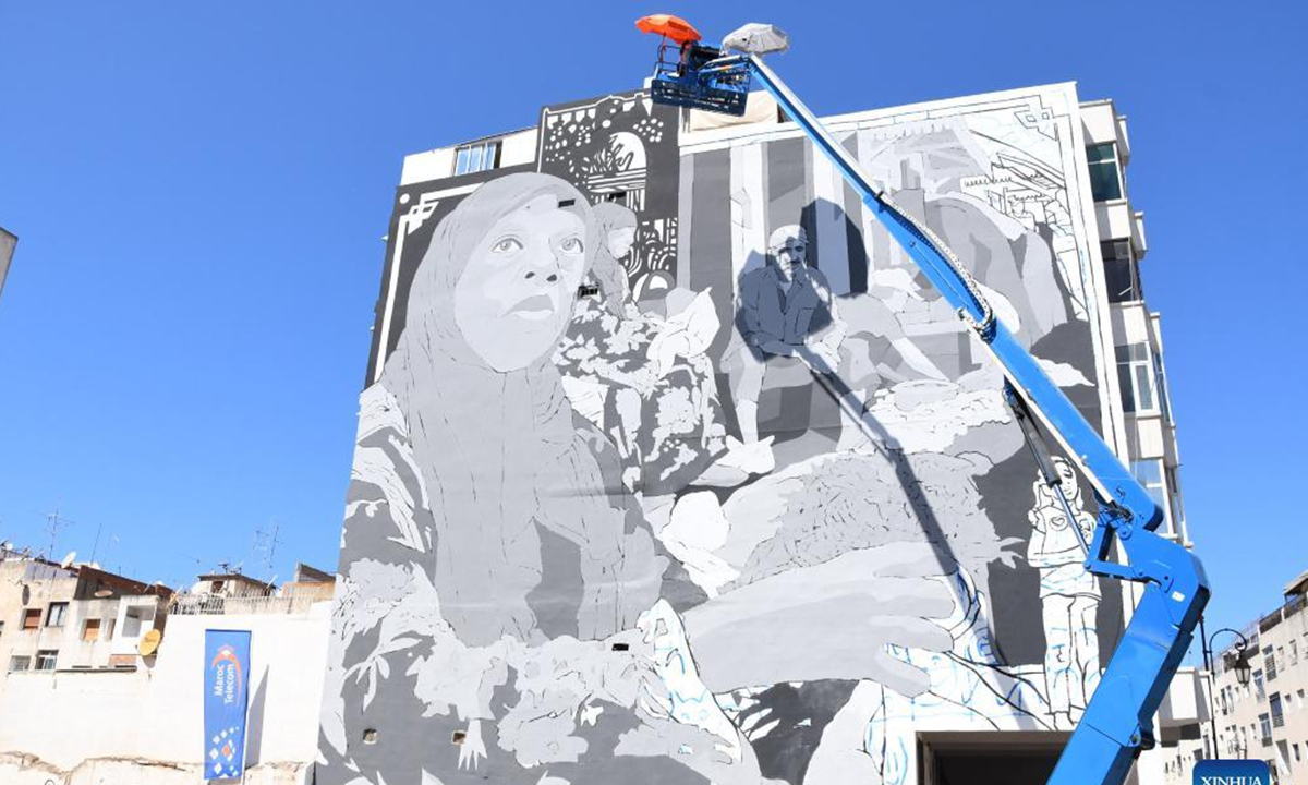 An artist paints a mural in Rabat, Morocco, Sept. 20, 2021. As an art festival is being held in Morocco, artists are painting murals to decorate building facades in the city of Rabat. The sixth edition of Jidar-Rabat Street Art Festival, lasting from Sept. 16 to 26, has attracted artists from countries including Morocco, Argentina, Spain and France. (Photo by Chadi/Xinhua)