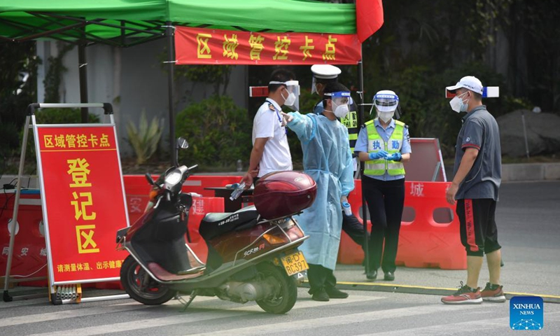 Staff members for COVID-19 response stand guard at a checkpoint in Tongan District of Xiamen City, southeast China's Fujian Province, Sept. 23, 2021.Photo:Xinhua