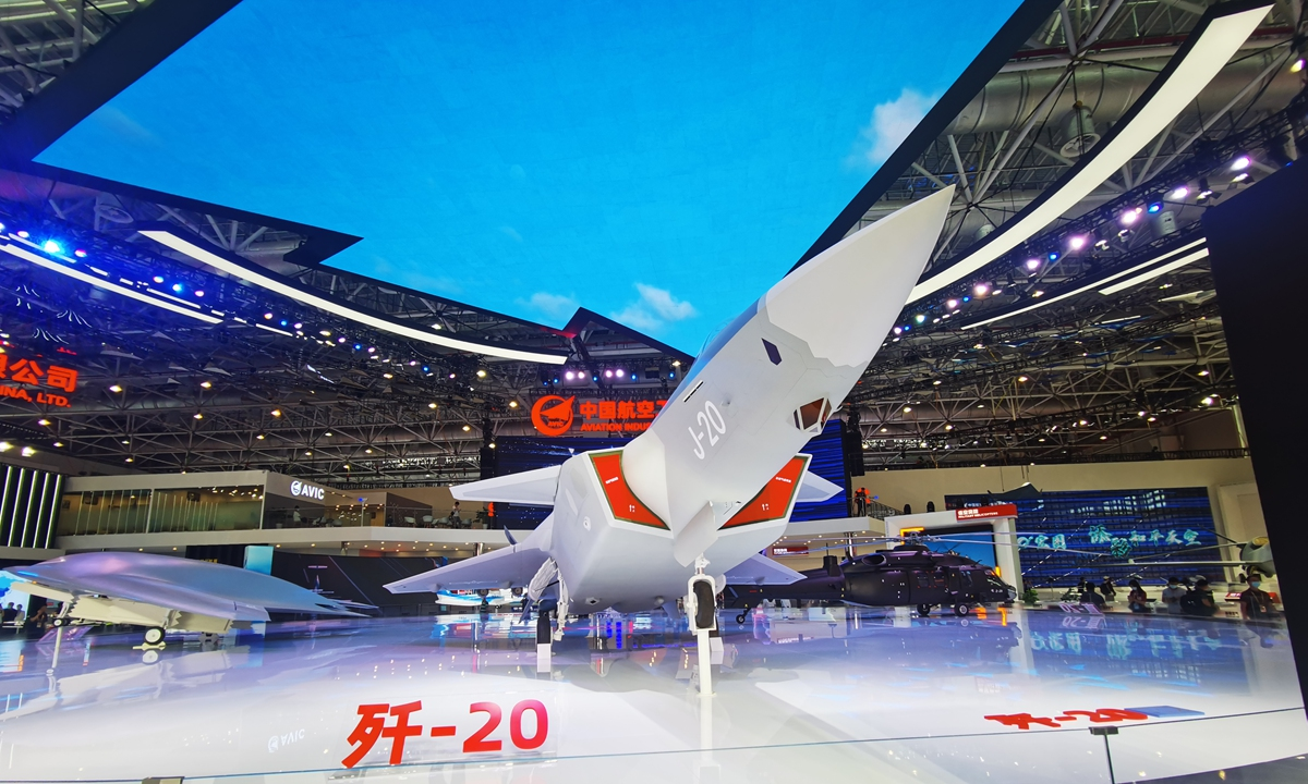 A model of a J-20 stealth fighter jet is on display at the exhibition stand of the Aviation Industry Corporation of China (AVIC), as the China Airshow 2021 in Zhuhai, South China's Guangdong Province, opened to media on Sunday. Models of other AVIC aircrafts of