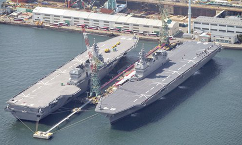 Photo taken on March 22, 2017 shows the Maritime Self-Defense Force's helicopter destroyer <em>Kaga</em> on the right, anchored in Yokohama, near Tokyo. Another helicopter destroyer <em>Izumo</em> is seen on the left. Photo: IC
