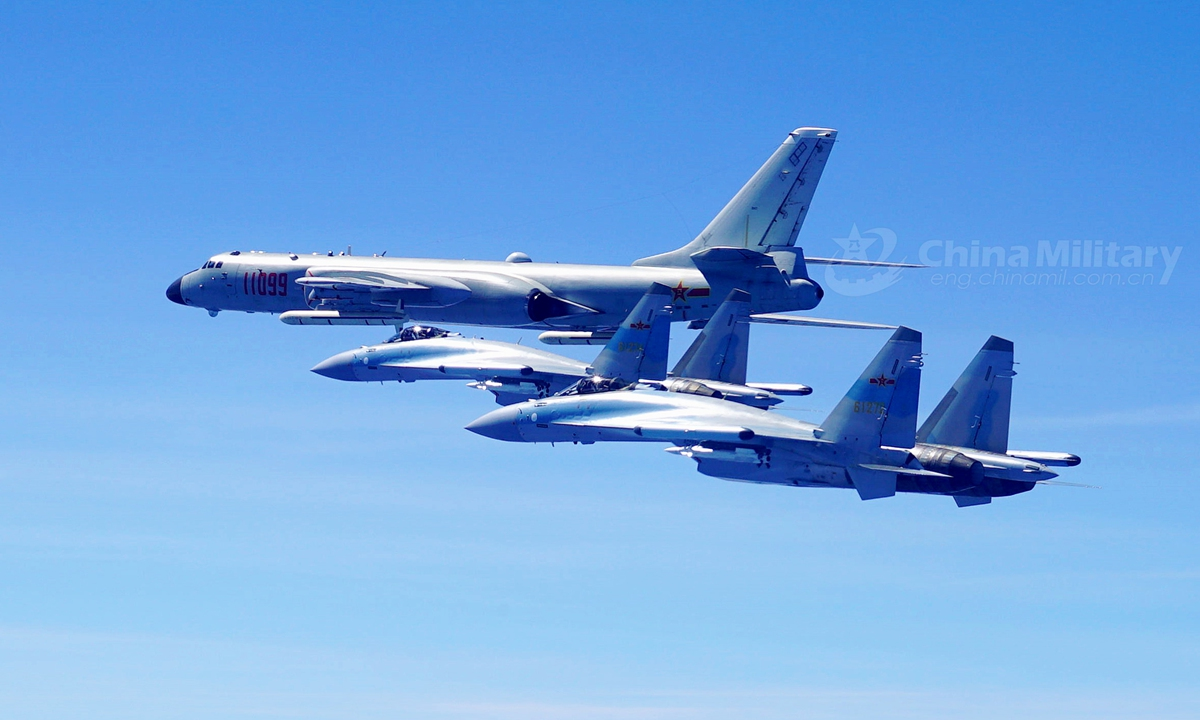 Two Su-35 fighter jets and a H-6K bomber fly in formation on May 11, 2018. The People's Liberation Army (PLA) air force conducted patrol training over China's island of Taiwan.File photo:China Military