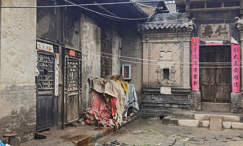 The photo taken on October 7, 2021 shows a building in Pingyao ancient city damaged by floods. Photo: CFP