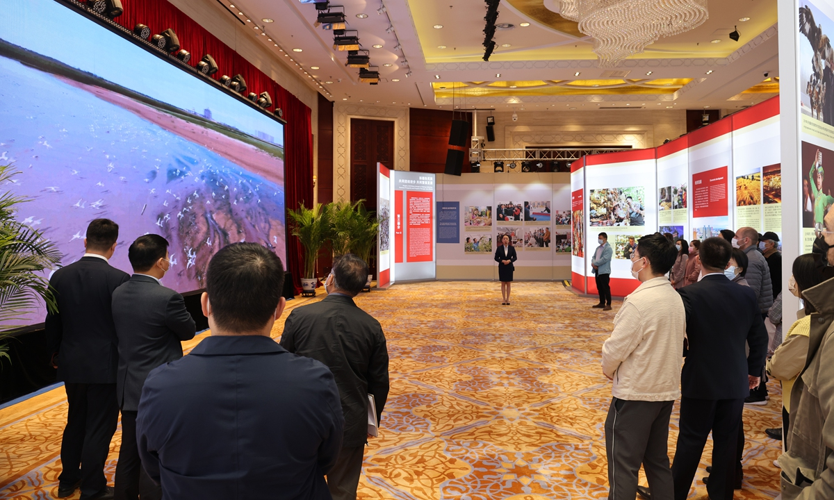 Journalists visit the counter-terrorism exhibit on Xinjiang in Beijing on Monday. Photo: Global Times