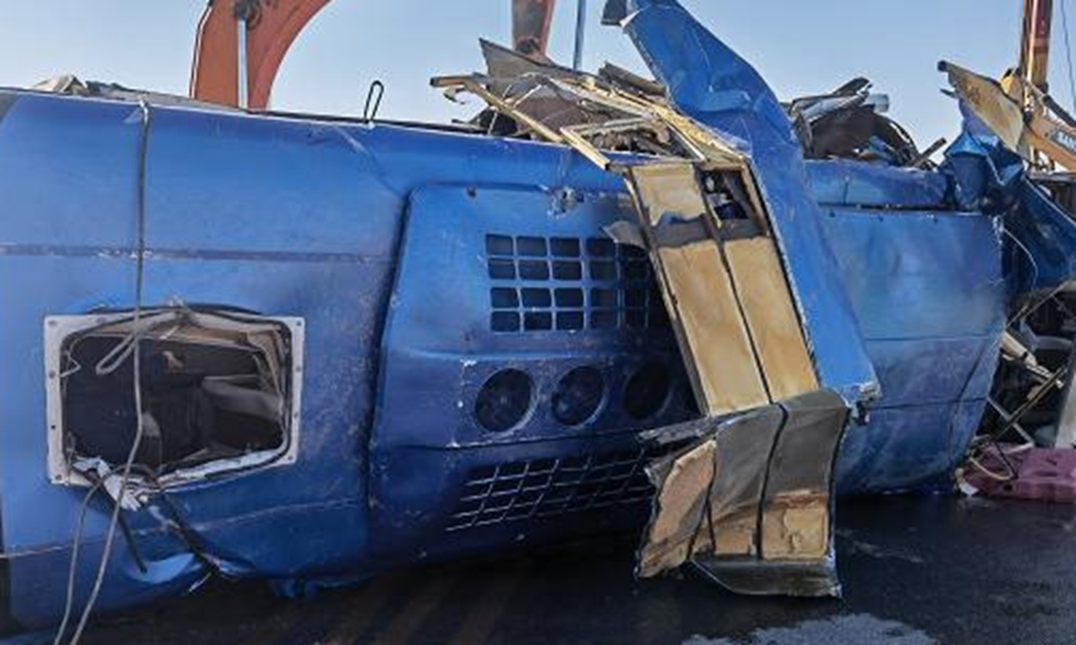 A bus is salvaged ashore after it crashed into a river in Pingshan County, North China's Hebei Province, on Monday morning. Photo: CCTV