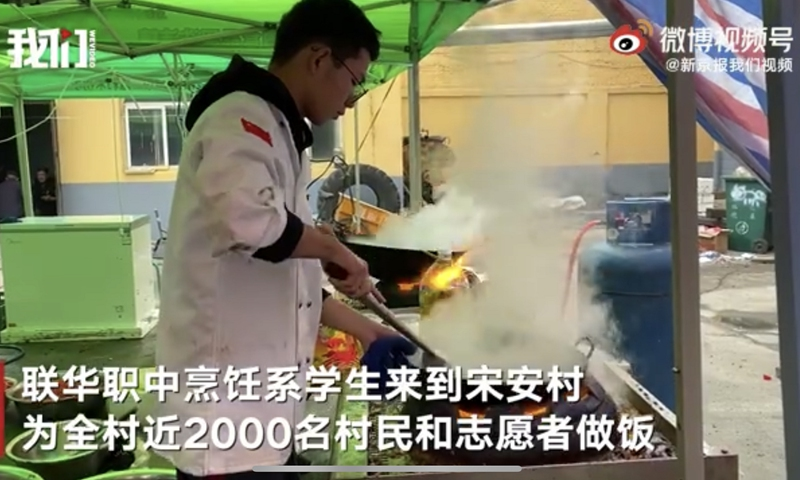 At a temporary shelter in a village in Shanxi's Jiexiu City, several young cooks were seen preparing the food, according to a video uploaded by The Beijing News on Wednesday. Photo: Sina Weibo