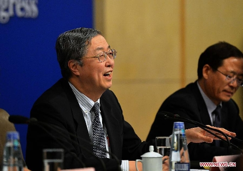 Zhou Xiaochuan, China's central bank governor, speaks at a news conference on China's currency policy and financial reform held by the first session of the 12th National People's Congress (NPC) in Beijing, capital of China, March 13, 2013. (Xinhua/Wang Song)